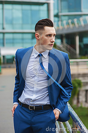 Businessman near office building