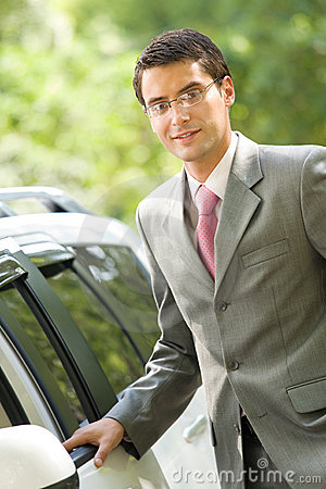 Businessman with new car