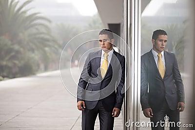Businessman next to the office door