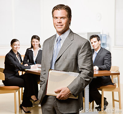 Businessman with notebook and co-workers