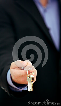 Businessman offering bunch of keys