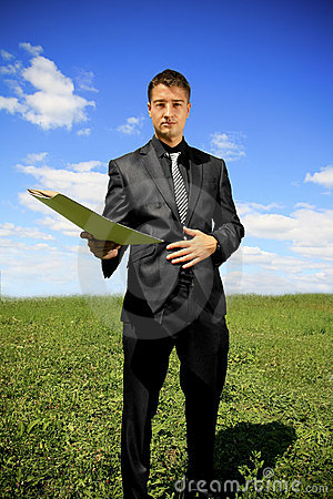 Businessman offering a folder