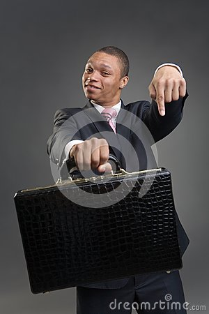 Businessman offers briefcase