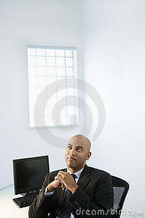 Businessman at office desk.