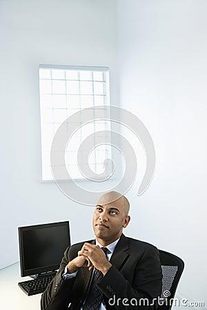 Businessman at office desk.