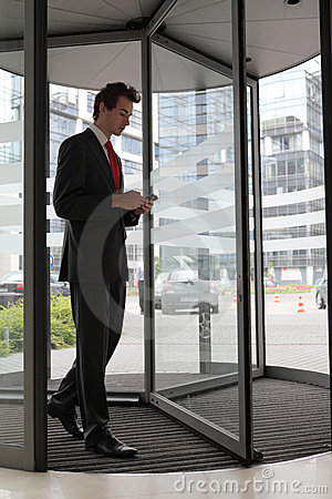 Businessman at office revolving door