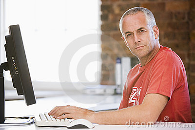 Businessman in office typing on computer