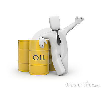 Businessman with oil barrels