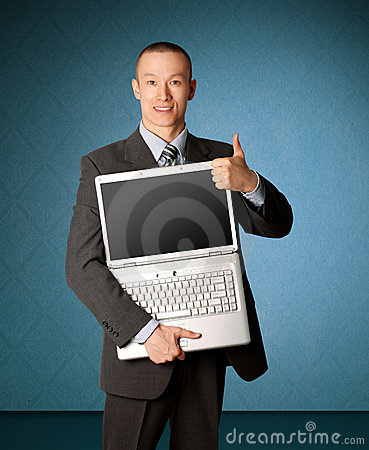 Businessman with open laptop shows welldone