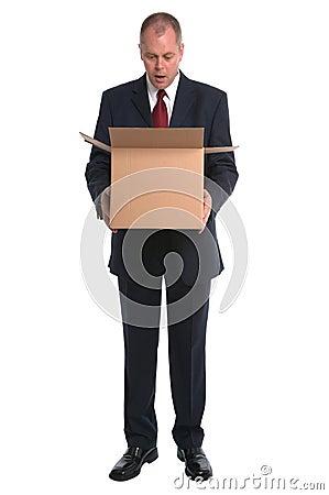 Businessman opening box
