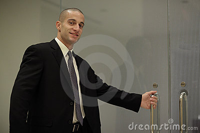 Businessman opening the door