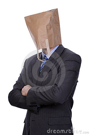 Businessman with paper bag on his head