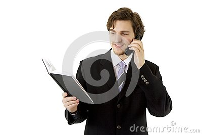 Businessman with phone and daily