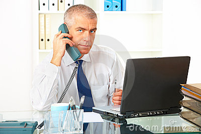 Businessman with phone and laptop