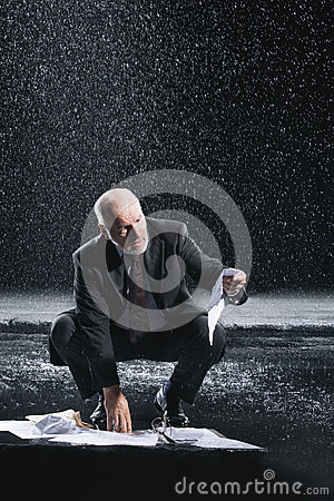 Free Businessman Picking Soaked Documents In Rain Royalty Free Stock Photography - 31840767