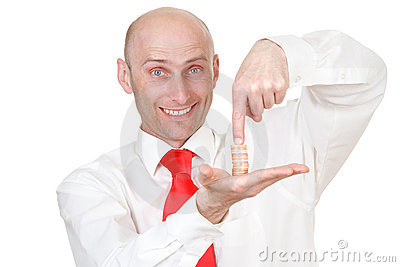 Businessman with pile of coins
