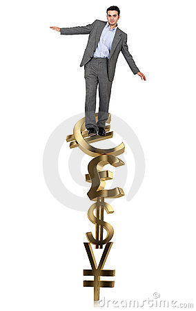 Businessman on a pile of currency symbols