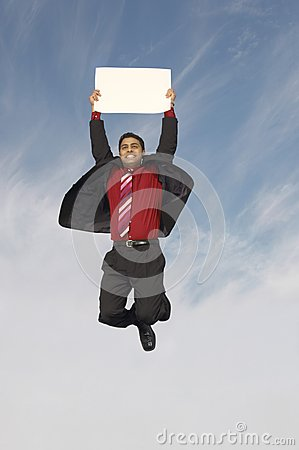 Businessman With A Placard In Midair