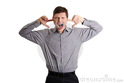 Businessman plugging her ears