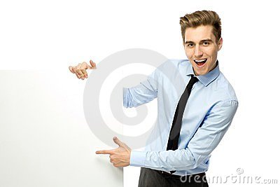 Businessman pointing at blank poster