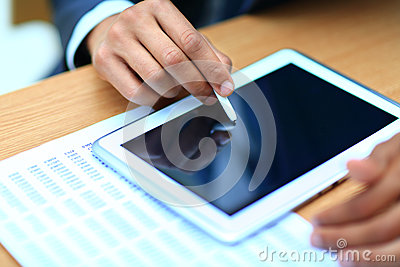 Businessman pointing on modern digital tablet
