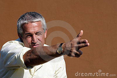 Businessman pointing/shooting