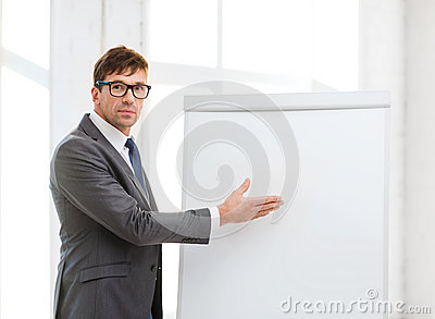Businessman pointing to flip board in office