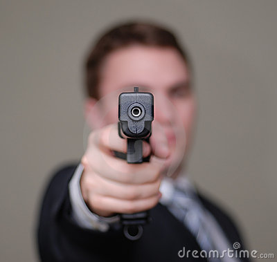 Free Businessman Points Gun With Shallow Depth Of Field Royalty Free Stock Image - 1854646