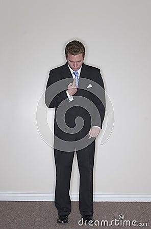 Businessman points at himself