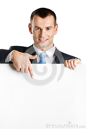 Businessman points at paper copy space