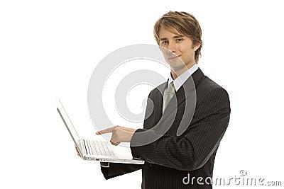 Businessman points to laptop