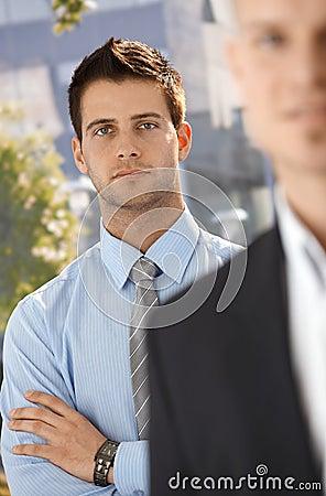 Businessman portrait with colleague