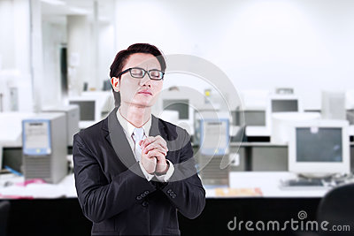 Businessman pray at office