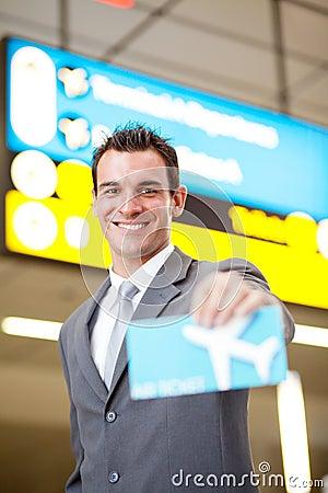 Businessman presenting air ticket