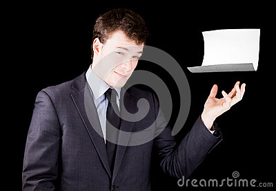 Businessman presenting a blank sheet of paper with room for text
