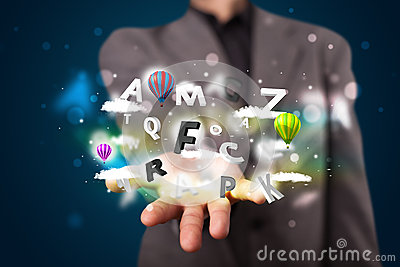 Businessman presenting magical clouds with letters and bal Stock Photo
