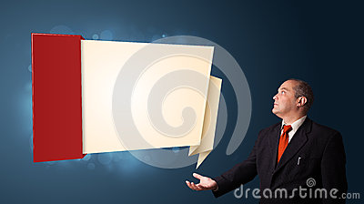 Businessman presenting modern origami copy space