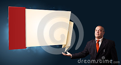 Businessman presenting modern origami copy space