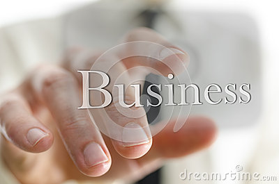 Businessman pressing Business  icon on a virtual screen