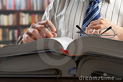 Businessman or professor reading journal