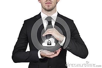 Businessman protecting cloud
