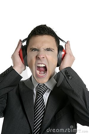 Businessman protecting from noise with headphones