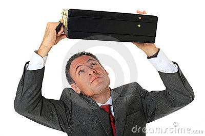 Businessman protects himself with suitcase