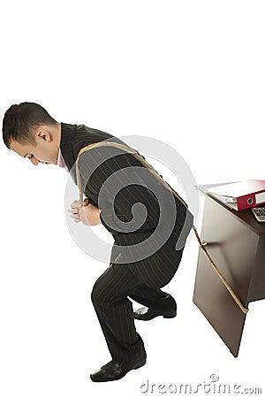 Businessman pulling a desk