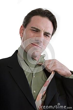 Businessman pulling tie