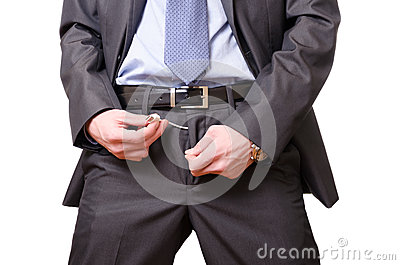 Businessman pulling a usb cable off his pants.