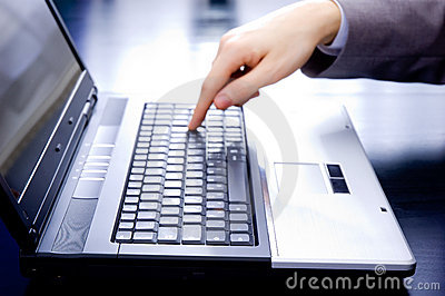 Businessman pushing the enter button