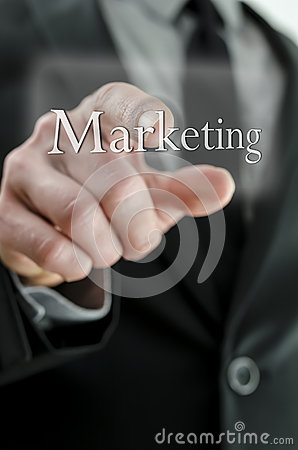 Businessman pushing Marketing button on a touch screen interface