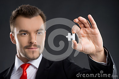 Businessman with puzzle element.