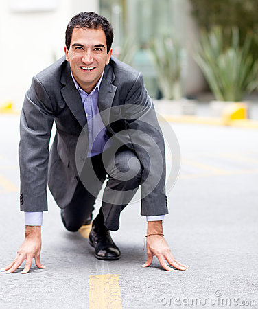 Businessman in racing position